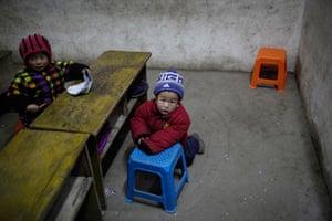 24 hours in pictures: Children play at a kindergarten in Ruzhou county