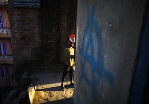 24 hours in pictures: A Nepalese boy playing with a mask