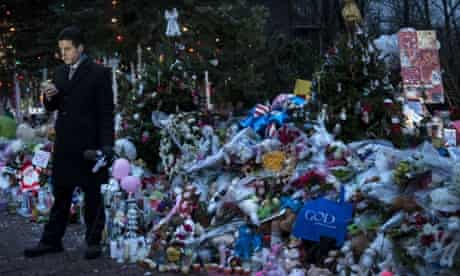 A TV reporter waits to do a standup report from a road side memorial dedicated to the victims of the shooting at Sandy Hook Elementary School in Newtown, Connecticut. Students in Newtown, excluding Sandy Hook Elementary School, returned to school for the first time since last Friday's shootingthat took the live of 20 students and 6 adults.