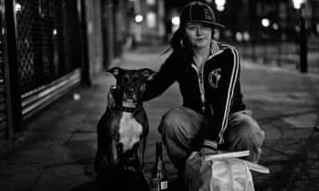 A woman and her dog near Kings Cross, London