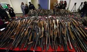 Guns are displayed on tables in Camden, New Jersey, after New Jersey Attorney General Jeffrey Chiesa announced that last weekend's gun buyback event brought in more than 1,100 guns.