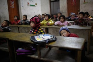 FTA: Aly Song: Children sit during a class at a kindergarten in Ruzhou county