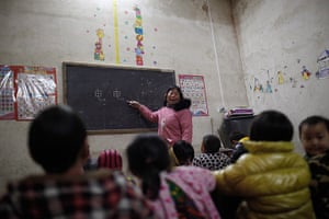 FTA: Aly Song: A teacher teaches children Chinese characters during a class