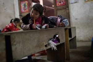 FTA: Aly Song: Children sit at their desks