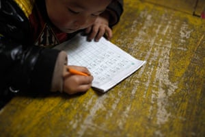 FTA: Aly Song: A child writes Chinese characters during a class at a kindergarten