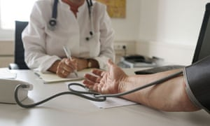 Doctor takes a patient's blood pressure