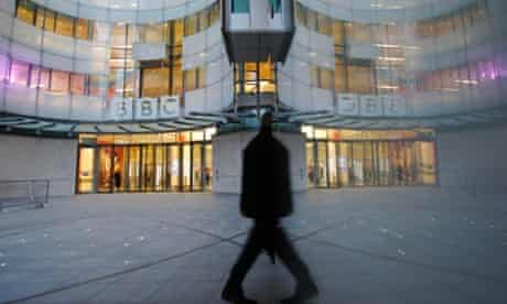 A man walks past the BBC's New Broadcasting House in London. More on the BBC's Pollard enquiry.