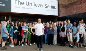 Tino Sehgal outside the Tate Modern with the participants in his These Associations artwork