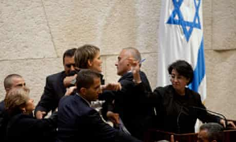 Haneen Zoabi facing a protest from an Israeli nationalist MP at the Knesset