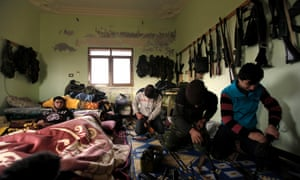 Syrian rebels clean their weapons at their headquarters in Maaret Ikhwan, near Idlib, Syria.