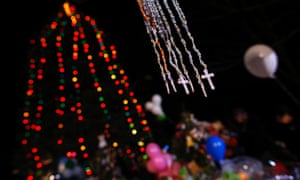 Crosses hang at a makeshift memorial outside Sandy Hook elementary school for the victims of the shootings in Newtown, Connecticut. Six funerals have been held.