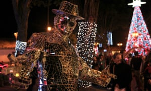 The man in the mirror. A man in a costume made out of mirrors poses in Usaquen Park during the annual Festival de Navidad celebrations in Bogota, Colombia.