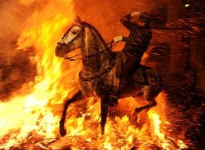 Pics of the Year 2012: Horse runs through fire by Jasper Juinen