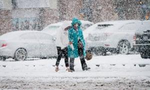 Residents walk through snow in Richmond, Canada