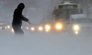 A brave woman heads out during a blizzard in central Varna, Bulgaria