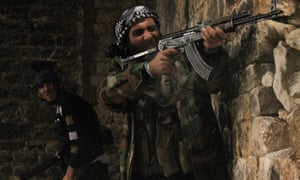 Free Syrian Army fighters take their positions during clashes with forces loyal to Syria's President Bashar al-Assad in Qastal Harami area in Aleppo.