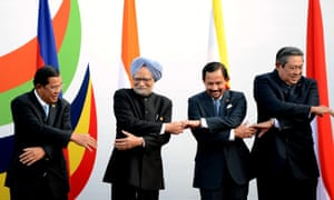 World leaders get some auld lang syne practice in. Prime Minister of Cambodia Hun Sen, Indian Prime Minister Manmohan Singh, Sultan of Brunei Haj Hassanal Bolkiah Waddaulah and the President of Indonesia Susilo Bambang Yudhoyono hold hands as they pose for a photo during the ASEAN-India Commemorative Summit in New Delhi, India.