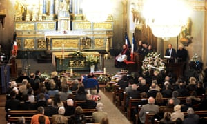 The coffin of French climber Maurice Herzog lies in Saint-Michel church, Chamonix, in the French Alps, during his funeral. Herzog, who conquered Annapurna in the first recorded ascent of a peak above 8,000 metres, died at the age of 93 on 13 December