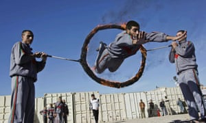 An Afghan policeman demonstrates their skills during a graduation ceremony in Herat, Afghanistan. Over 200 police security forces including eight female policewomen graduated after receiving six months of training in Herat.