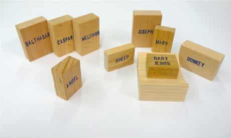 Emilie Voirin's Minimal Nativity with writing on wooden blocks