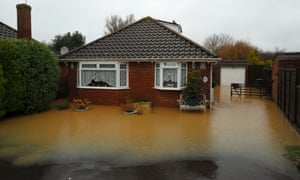 Rising flood waters surround a property in Emsworth, Hampshire. More than 20 flood warnings are in place around the country as rain is expected to continue into next week.