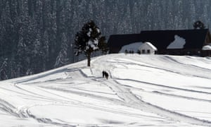 A group a tourists walk on the snow covered slopes in Gulmarg ski resort near Srinagar, India. Kashmir is currently in the grips of a cold spell. From 21 December, a forty-day of period of harsh winter, known as Chilla Kalan, will begin with an extreme below-freezing night temperatures. The period lasts until 31 January.