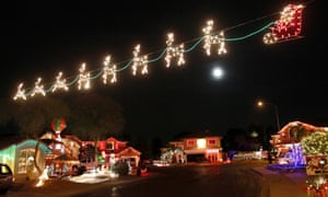 Is there a bit of competition going on? Christmas lights stretch across the street on Natal Circle in Gilbert, Arizona.