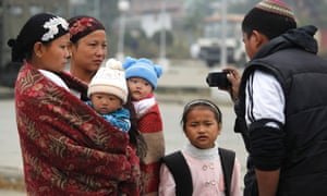 A relative of Bnei Menashe Jewish community takes photograph of his family leaving for Israel in Imphal, India. The Jews from Manipur claim to be descendants of one the ten lost tribes of Israel banished to India in the eighth century B.C. An Israeli chief rabbi recognized them as a lost tribe in 2005 and about 1,700 have moved to Israel before the Israeli government stopped giving them visas. The government recently reversed that policy and about 50 of the 7,200 remaining in India were heading to the Jewish state.