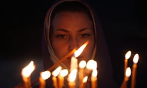 A worshipper lights a candle in the Church of the Nativity in the West Bank town of Bethlehem.