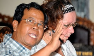 Lindsay Sandiford (right) listens to her interpreter during her trial in Denpasar
