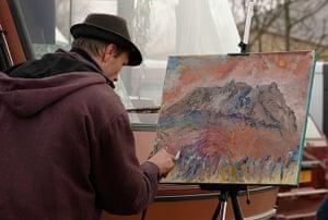 Bugarach prophecy: A tourist paints the Pic de Bugarach