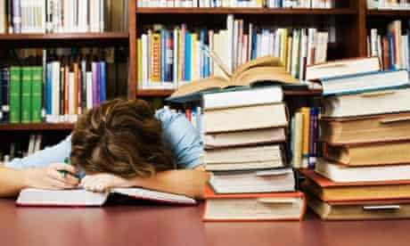 Exhausted Student Falling Asleep While Cramming