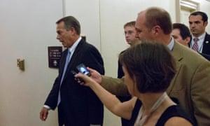 Speaker John Boehner leaves a House Republicans meeting