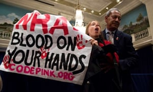 A protestor is removed by a security guard during a speech by Wayne LaPierre, the executive vice president of the National Rifle Association during a news conference in Washington.