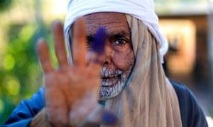 Egyptian referendum voter shows inked finger