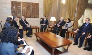 Syria's President Bashar al-Assad meets international peace envoy for Syria, Lakhdar Brahimi in Damascus on 24 December.