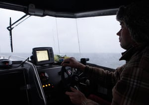 Living in a freezer: Ervin Koppel drives his motorboat to Osmussar island