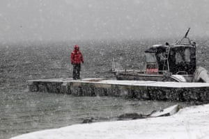 Living in a freezer: Rita Koppel stands on the pier during snowfall