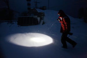 Living in a freezer: Koppel holds a torch as she walks to the cellar in Osmussaar island