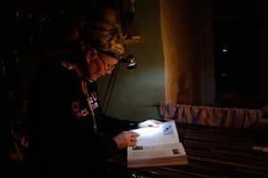 Living in a freezer: Rita Koppel uses head torch to read a book