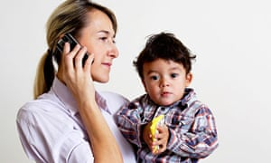 Mother holding baby and phone