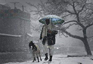 24 hours in pictures: An Afghan man walks with his goat in Kabul