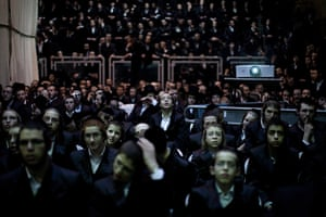 24 hours in pictures: Ultra-Orthodox watch on a big screen the wedding ceremony