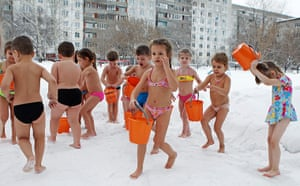 24 hours in pictures: hildren pour cold water on themselves in snow