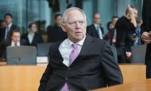 German finance minister Wolfgang Schaeuble arrives at his table at the Bundestag committee of inquiry.