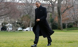 President Obama walks across the South Lawn