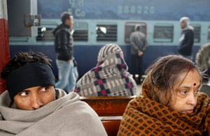 24 hours in pictures: Cold passengers wait for the arrival of a train