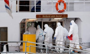 Paramedics enter the Bellriva, in Wiesbaden, amid Norovirus outbreak