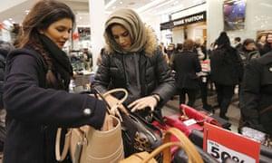 Shoppers inspect handbags
