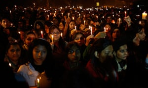 India: People hold candles as they mourn the death of a gang rape victim